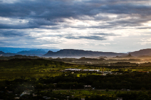 View of Sogeri mountain range from Rainbow at daybreak with fog and cloudy sky over looking UPNG